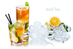 Iced tea. Concept. Glasses with ice tea and frosted glassware with ice cubes and ingredients Stock Photography