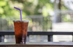 Iced tea in a glass on the wooden table royalty free stock photos