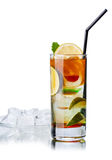 Iced tea. In highball glass with black straw near a transparent saucer with ice cubes Stock Image