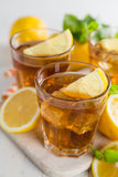 Iced tea with lemon and mint Stock Photo