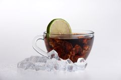 Iced tea with lemon and mint  on white Royalty Free Stock Photos