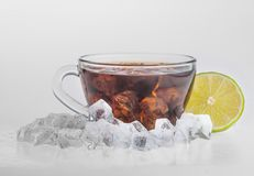 Iced tea with lemon and mint  on white Stock Photo