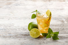Iced tea. With lemon and mint on wooden table royalty free stock photography