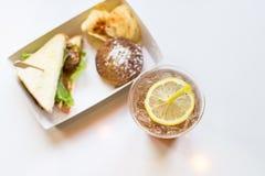Iced tea and lemon with sandwiches Stock Photos