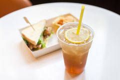Iced tea and lemon with sandwiches Stock Photo