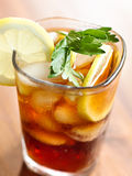 Iced tea with lemon slice and leaf garnish. Stock Photography