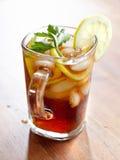 Iced tea with lemon slice and leaf garnish. Stock Images
