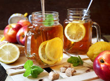 Iced tea with lemon slices and fruits Stock Images