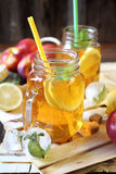 Iced tea with lemon slices and nectarines Royalty Free Stock Photography
