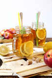 Iced tea with lemon slices and nectarines Stock Photography