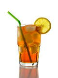 Iced Tea and Lemon, Straw. A glass full of Ice Tea with a lemon slice and straw Royalty Free Stock Images