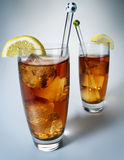 Iced tea. With lemon on white background royalty free stock photos