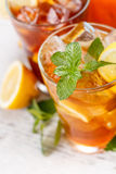 Iced tea. Mint leaf and lime slice on the top of iced tea royalty free stock images