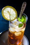 Iced Tea with Mint and Lemon. In tall glass Stock Photo