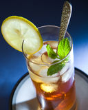 Iced Tea with Mint and Lemon. In tall glass royalty free stock photos