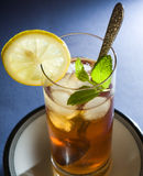 Iced Tea with Mint and Lemon. In tall glass royalty free stock photo