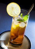 Iced Tea with Mint and Lemon. In tall glass Stock Photos