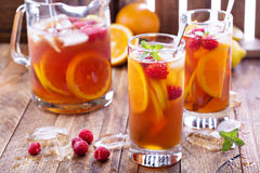Iced tea with orange and raspberry Stock Photography