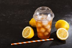 Iced tea in plastic glass with fresh fruits Royalty Free Stock Photography