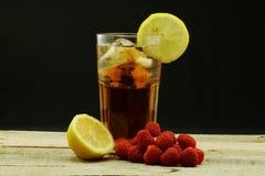 Iced Tea and Raspberries Royalty Free Stock Image