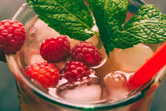 Iced tea with raspberries and mint Royalty Free Stock Photo