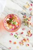 Iced tea with a tea rose. Cold cocktail stock photos