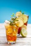 Iced tea. Summer iced tea with lemon, ice cube and mint stock photos