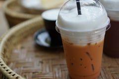 Iced Thai milk tea with  milk foam. In plastic glass Stock Image