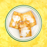 Iced toaster pastries on plate with yellow background Royalty Free Stock Photos