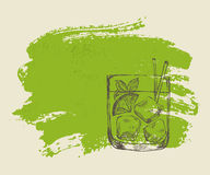 Iced tropical cocktail with mint on green background. Iced tropical cocktail with mint on green grunge background Stock Image
