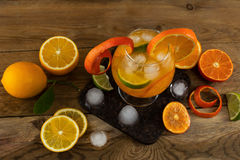 Iced tropical fruit cocktail on wooden table Stock Photos