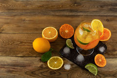 Iced tropical fruit cocktail on wooden table top view Royalty Free Stock Photos