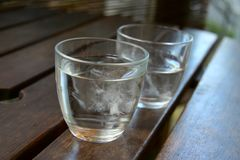 Iced water in glasses. Two glasses of refreshing iced water in closeup Stock Photos