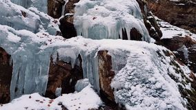 Iced waterfall on cliff stock footage