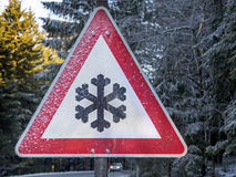 Iced winter warning traffic sign on road Royalty Free Stock Photos