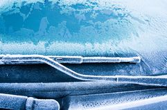 The ice-cold frost forms ice crystals in beautiful unique patterns on the Car Royalty Free Stock Image
