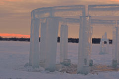 Icehenge. Large blocks of ice forming a Stonehenge replica in a close up view at sunset on a cold winters day in Wisconsin Stock Images