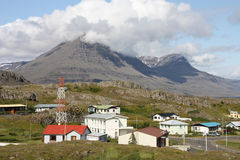 Iceland. Homes in Djupivogur, small town in Iceland. Mountains in the background Stock Image