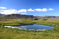 Iceland. Beautiful mountains, lake reflection and rural homes in Arnarstapi village. Snaefellsnes peninsula, Iceland Royalty Free Stock Photos