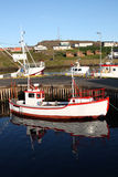 Iceland. Djupivogur - small fishing town in Iceland. Ships in harbor. Water reflection Royalty Free Stock Images