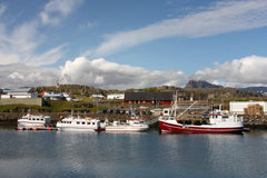 Iceland. Djupivogur - small fishing town in Iceland. Ships in harbor. Water reflection Stock Photo