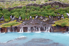 Iceland. A frontal view of Hraunfossar waterfalls Royalty Free Stock Images