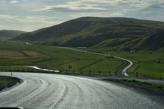 Iceland: agricultural fields, river, mountains and curvy roads royalty free stock photo