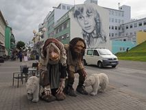 Two trolls and polar bears figurine on main street downtown Akureyri city center Iceland stock photography