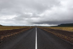 Iceland asphalt road leading straight to the. Stock Photography