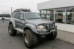 All terrain vehicle. Iceland, August 24, 2017: Specialty all terrain vehicle with massive wide tires is parked near a gas station Stock Photos