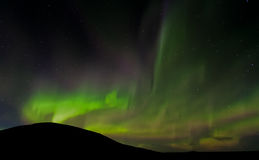 Iceland Aurora. Night photography of Iceland with aurora borealis and stars Royalty Free Stock Photography