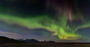 Iceland Aurora. Night photography of Iceland with aurora borealis and stars Stock Image