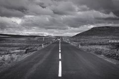 Iceland black white. Straight road in Iceland. Volcanic area of Krafla. Vanishing point. Black and white tone - retro monochrome color style Royalty Free Stock Images