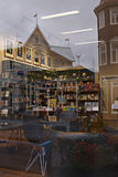 Iceland: Bookstore in Akureyri. Reflections of a Nordic city near to arctic circle in a window of a bookstore in Akureyri - the second city of Iceland. Despite Royalty Free Stock Images